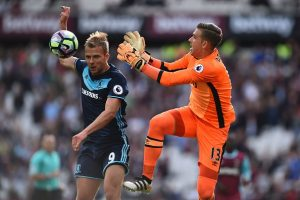 West Ham United's Spanish goalkeeper Adrian (R) goes for a high ball against Middlesbrough's English-born Scottiish striker Jordan Rhodes (L) but fails to gather during the English Premier League football match between West Ham United and Middlesbrough at The London Stadium, in east London on October 1, 2016. / AFP / GLYN KIRK / RESTRICTED TO EDITORIAL USE. No use with unauthorized audio, video, data, fixture lists, club/league logos or 'live' services. Online in-match use limited to 75 images, no video emulation. No use in betting, games or single club/league/player publications.  /         (Photo credit should read GLYN KIRK/AFP/Getty Images)