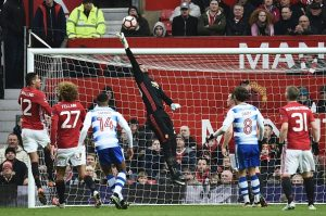 Manchester United's Argentinian goalkeeper Sergio Romero (C) reaches for the ball during the English FA Cup third round football match between Manchester United and Reading at Old Trafford in Manchester, north west England, on January 7, 2017. / AFP / Oli SCARFF / RESTRICTED TO EDITORIAL USE. No use with unauthorized audio, video, data, fixture lists, club/league logos or 'live' services. Online in-match use limited to 75 images, no video emulation. No use in betting, games or single club/league/player publications.  /         (Photo credit should read OLI SCARFF/AFP/Getty Images)