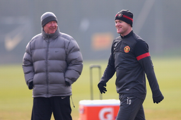 Wayne Rooney and Sir Alex Ferguson look on during a training session at Carrington Training Ground