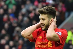 Liverpool's English midfielder Adam Lallana reacts after a missed chance during the English Premier League football match between Liverpool and Swansea City at Anfield in Liverpool, north west England on January 21, 2017. / AFP / Anthony DEVLIN / RESTRICTED TO EDITORIAL USE. No use with unauthorized audio, video, data, fixture lists, club/league logos or 'live' services. Online in-match use limited to 75 images, no video emulation. No use in betting, games or single club/league/player publications.  /         (Photo credit should read ANTHONY DEVLIN/AFP/Getty Images)