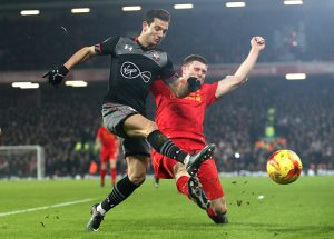 LIVERPOOL, ENGLAND - JANUARY 25:  Cedric Soares of Southampton and James Milner of Liverpool clash during the EFL Cup Semi-Final Second Leg match between Liverpool and Southampton at Anfield on January 25, 2017 in Liverpool, England.  (Photo by Julian Finney/Getty Images)