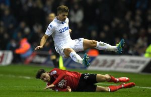 LEEDS, ENGLAND - JANUARY 25:  Gaetano Berardi of Leeds United rides a tackle from Matty Cash of Nottingham Forest during the Sky Bet Championship match between Leeds United and Nottingham Forest at Elland Road on January 25, 2017 in Leeds, England.  (Photo by Gareth Copley/Getty Images)