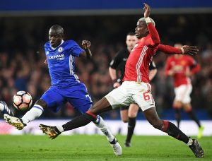 Chelsea's French midfielder N'Golo Kante (L) vies with Manchester United's French midfielder Paul Pogba during the English FA Cup quarter final football match between Chelsea and Manchester United at Stamford Bridge in London on March 13, 2017. / AFP PHOTO / Justin TALLIS / RESTRICTED TO EDITORIAL USE. No use with unauthorized audio, video, data, fixture lists, club/league logos or 'live' services. Online in-match use limited to 75 images, no video emulation. No use in betting, games or single club/league/player publications.  /         (Photo credit should read JUSTIN TALLIS/AFP/Getty Images)