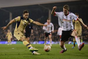 LONDON, ENGLAND - MARCH 18:  Billy Sharp of Leeds United is blocked by Michael Turner of Fulham during the Sky Bet Championship match between Fulham and Leeds United at Craven Cottage on March 18, 2015 in London, England.  (Photo by Jamie McDonald/Getty Images)