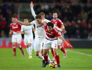 MIDDLESBROUGH, ENGLAND - DECEMBER 17:  Angel Rangel of Swansea City (L) and Fabio Da Silva of Middlesbrough (R) battle for possession during the Premier League match between Middlesbrough and Swansea City at Riverside Stadium on December 17, 2016 in Middlesbrough, England.  (Photo by Alex Livesey/Getty Images)