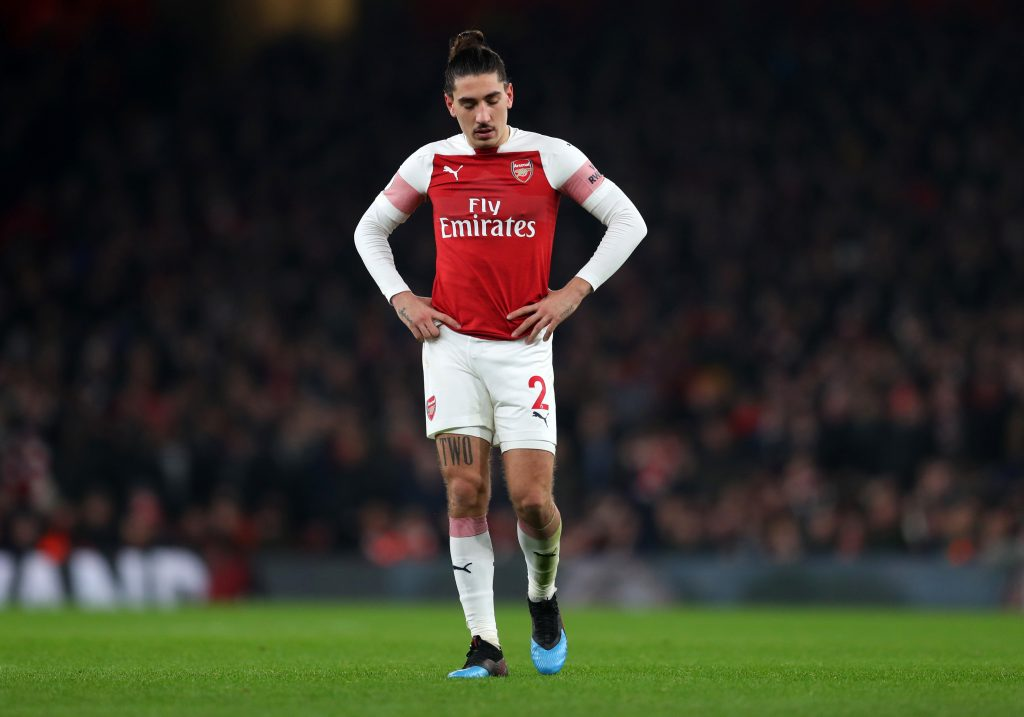 Barcelona eyeing a loan move for Arsenal full-back Hector Bellerin who looks dejected in the photo