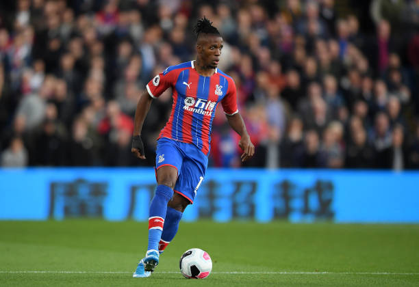 Zaha, who is in action in the photo, feels 'amazing' being linked with Arsenal last summer