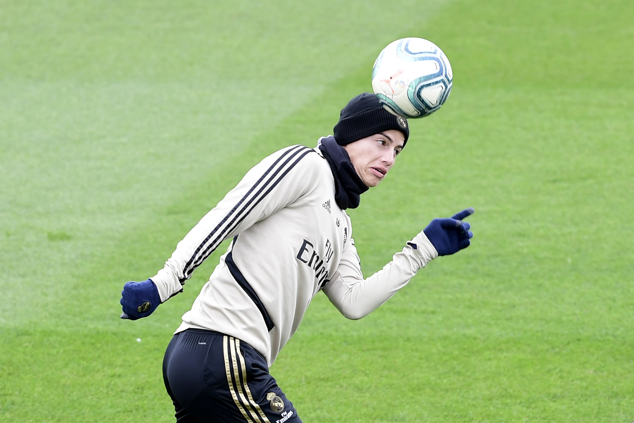 James Rodríguez heads a ball during a training session at the club's training ground