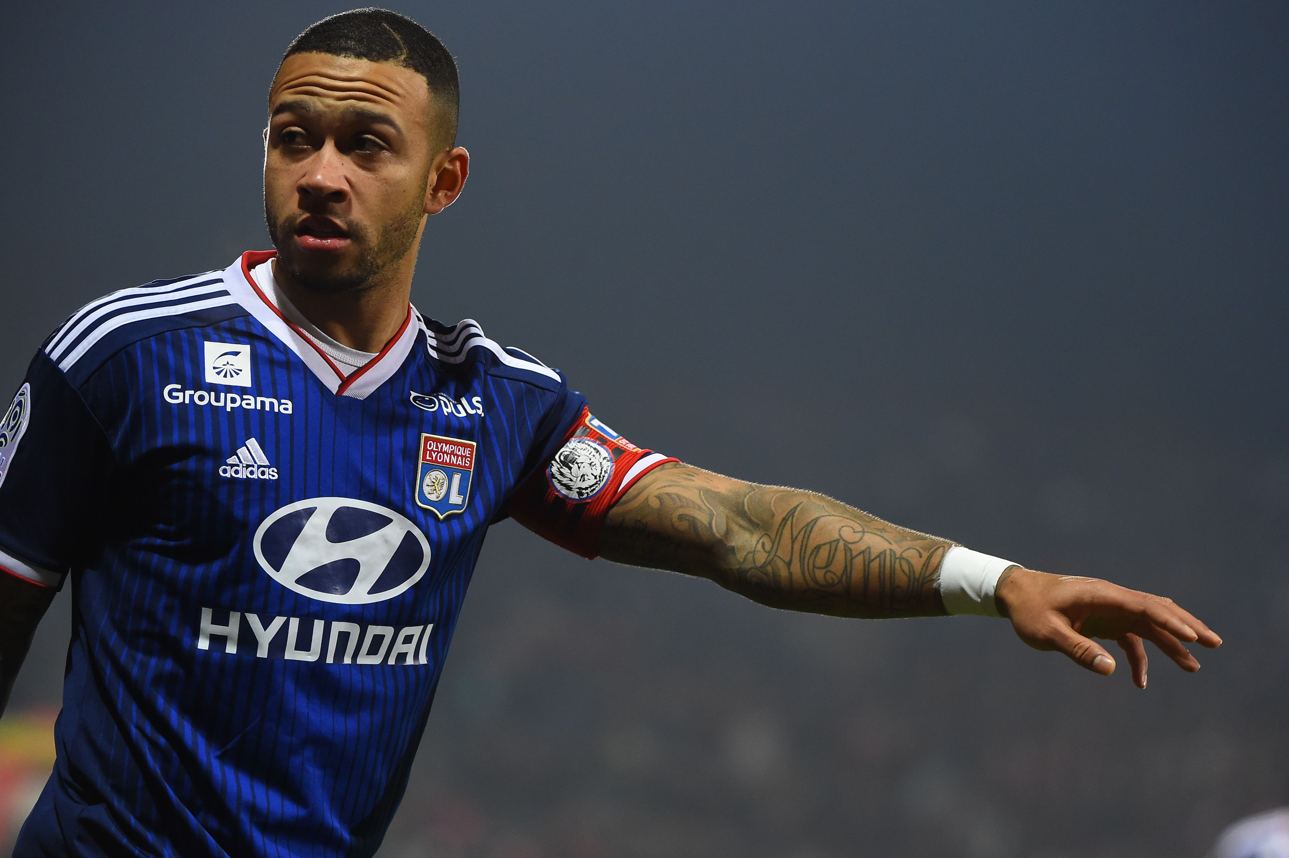 Liverpool will attempt to beat Barcelona for Memphis Depay who is seen in the photo