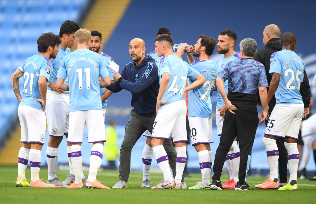 Manchester City Predicted Lineup Vs Newcastle United (Pep Guardiola seen talking to his players in the photo)