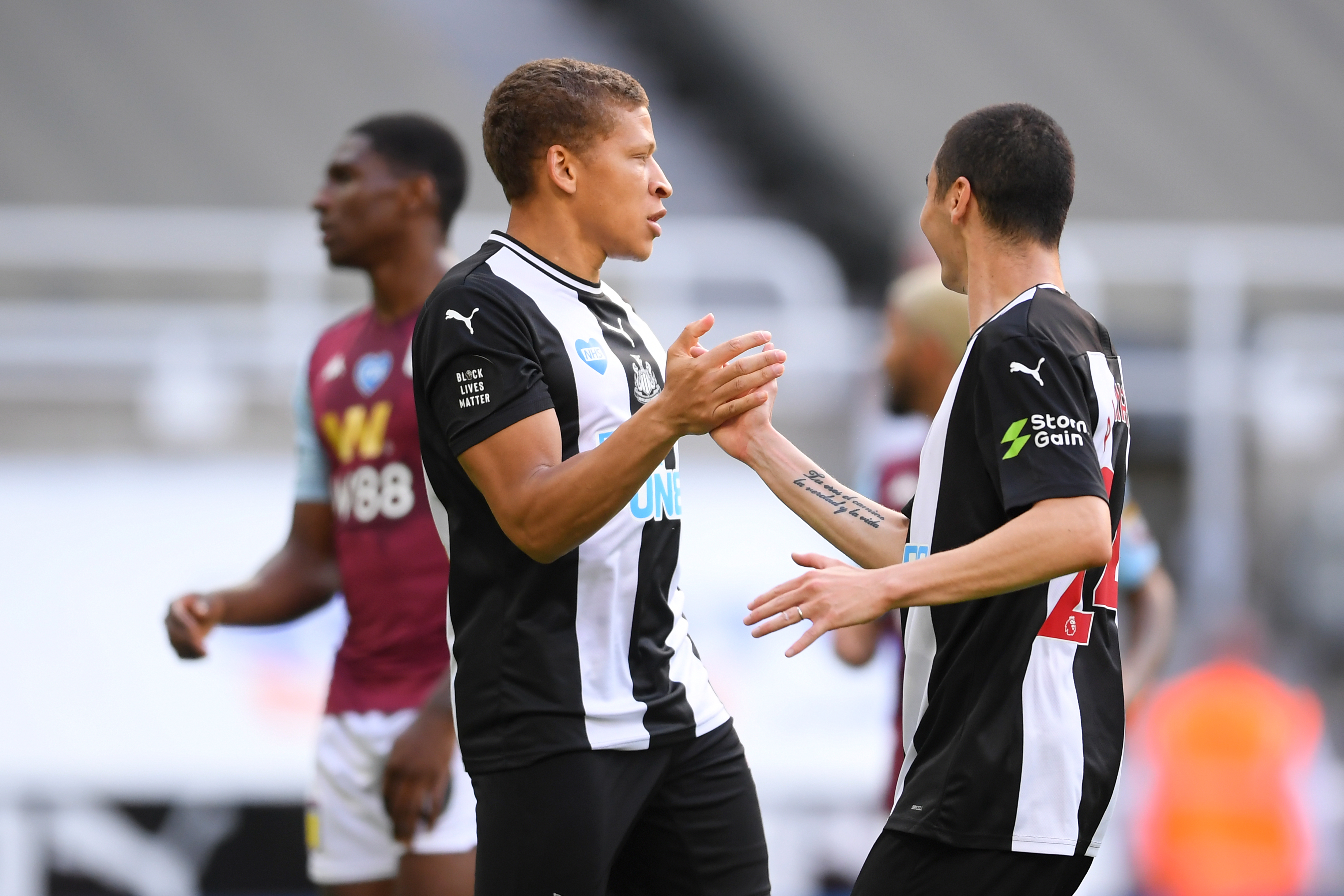 Newcastle United's Dwight Gayle is on Fulham's radar this month (Gayle is in action in the photo)