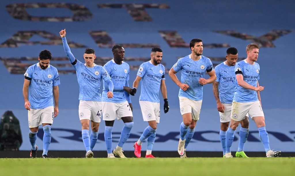 4-3-3 Manchester City Predicted Lineup Vs FC Porto (Man City players are celebrating in the photo)