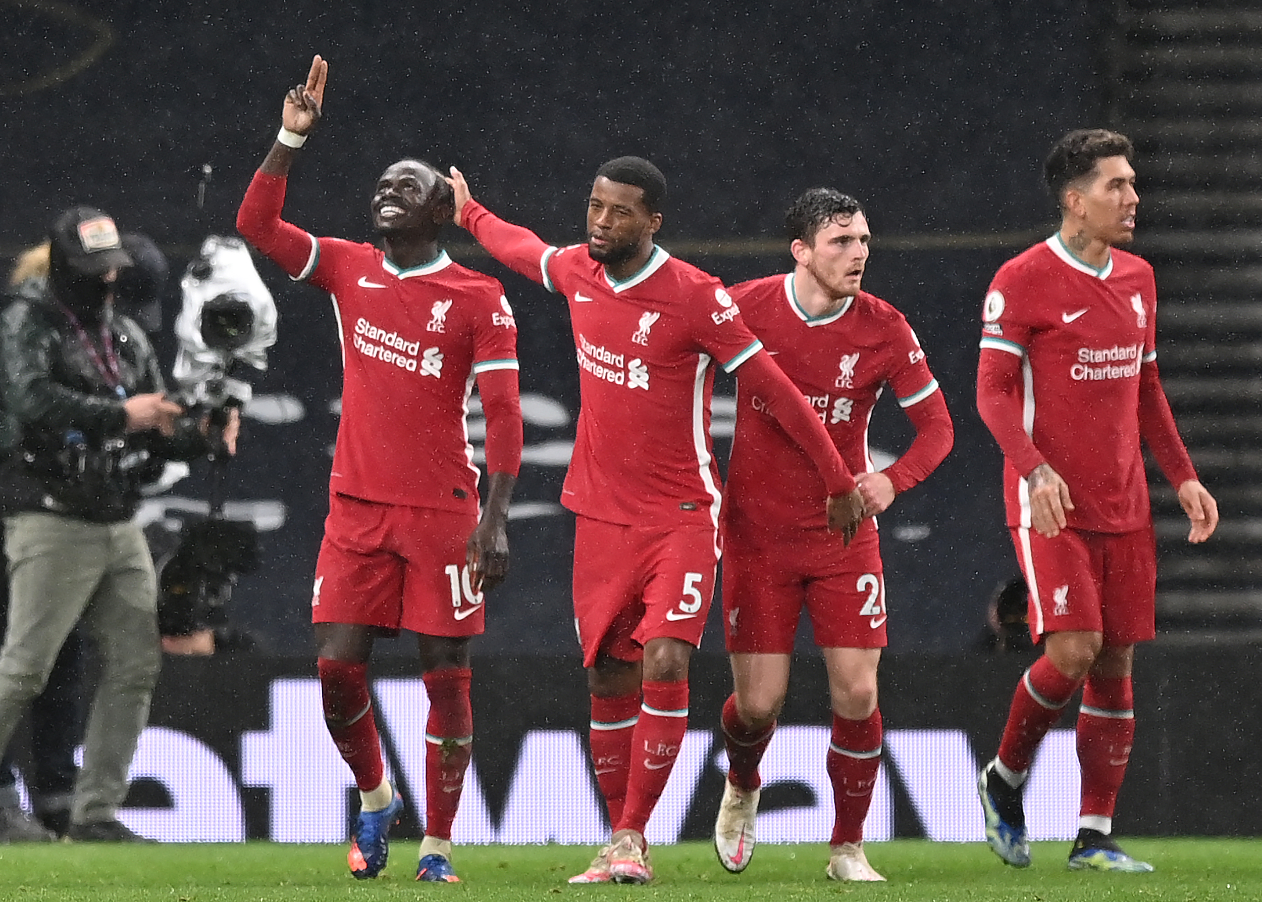 (Liverpool players are celebrating in the picture)