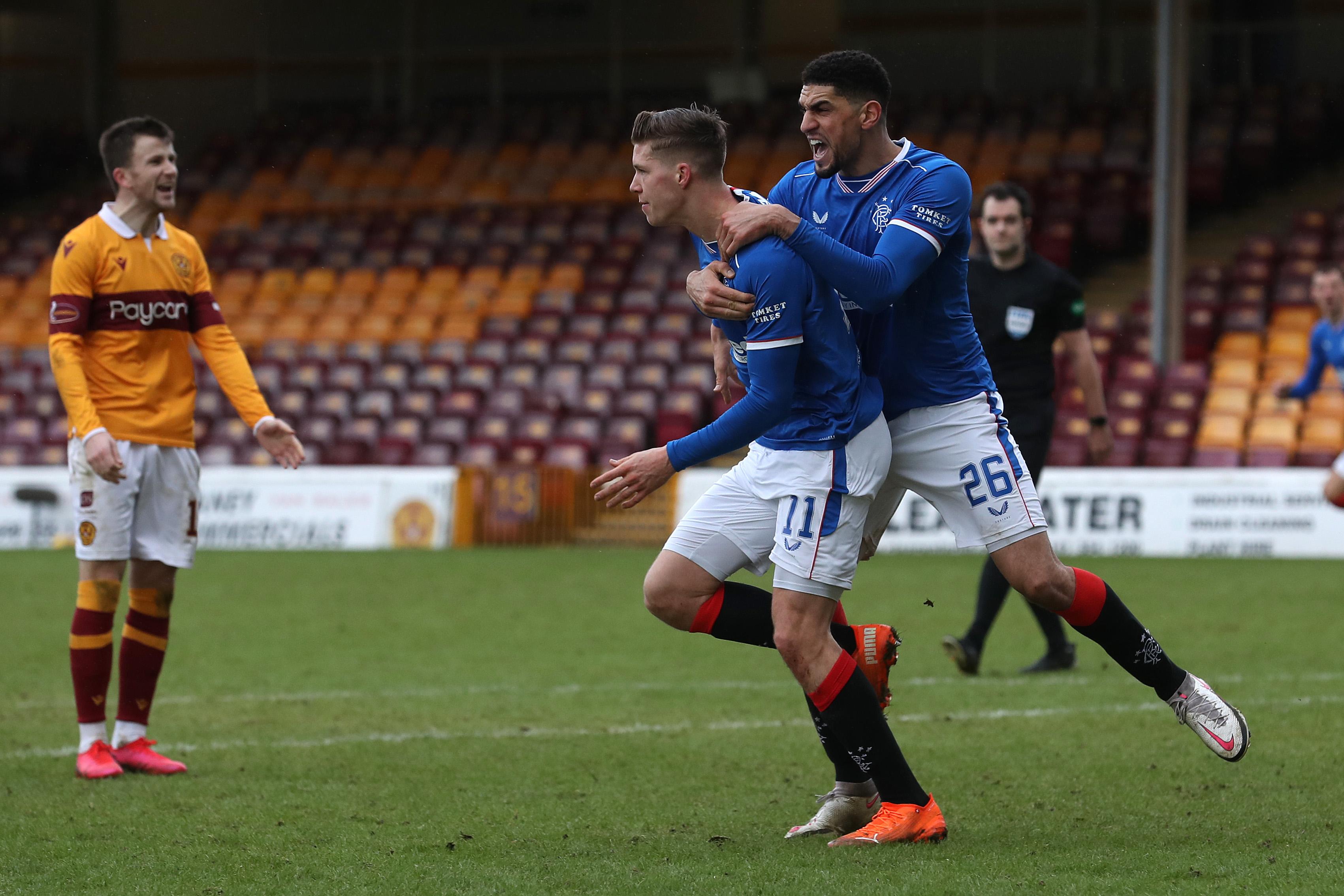 Rangers defender Leon Balogun celebrating Cedric Itten's goal against Motherwell