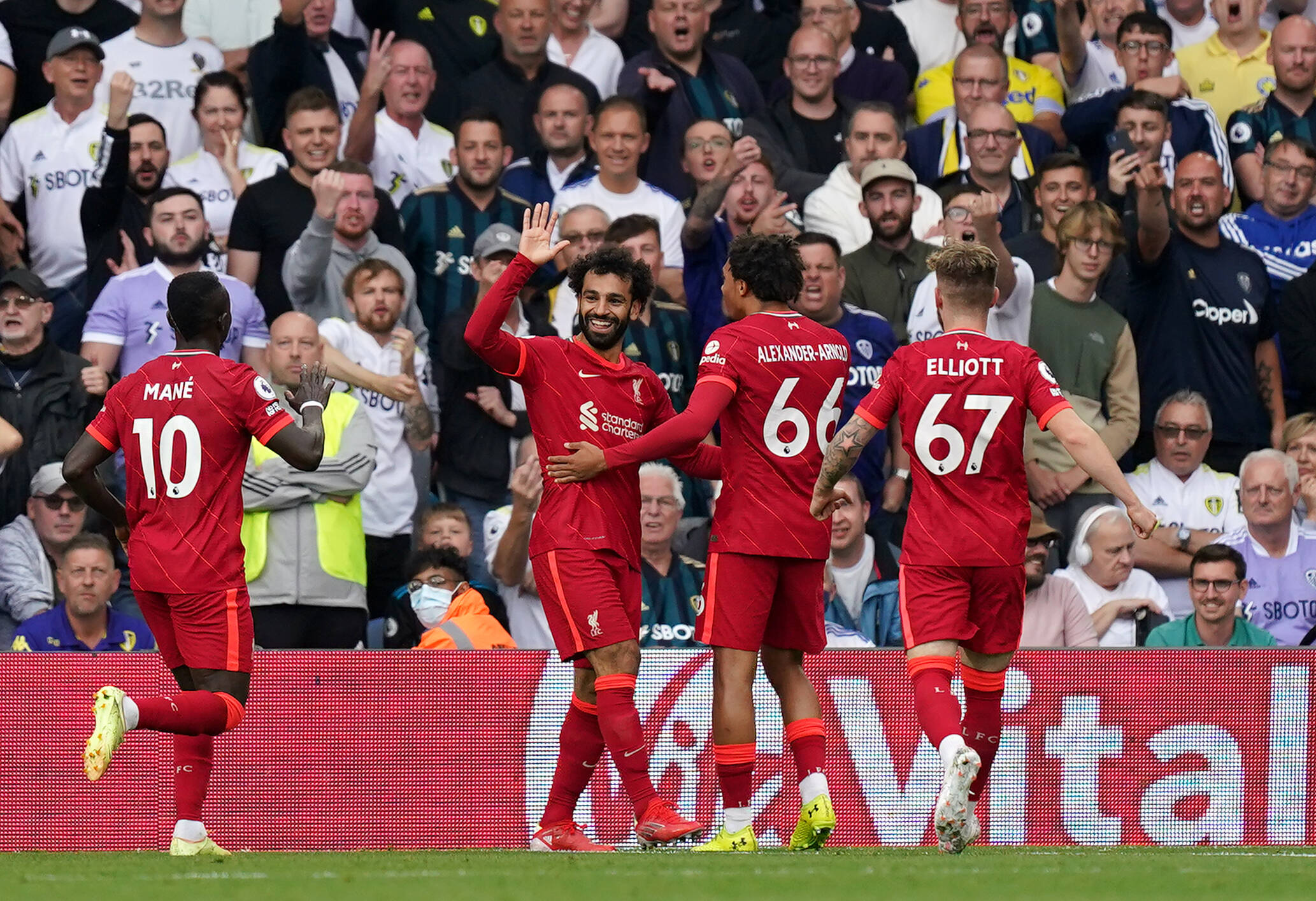 Liverpool players celebrating a goal against Leeds United